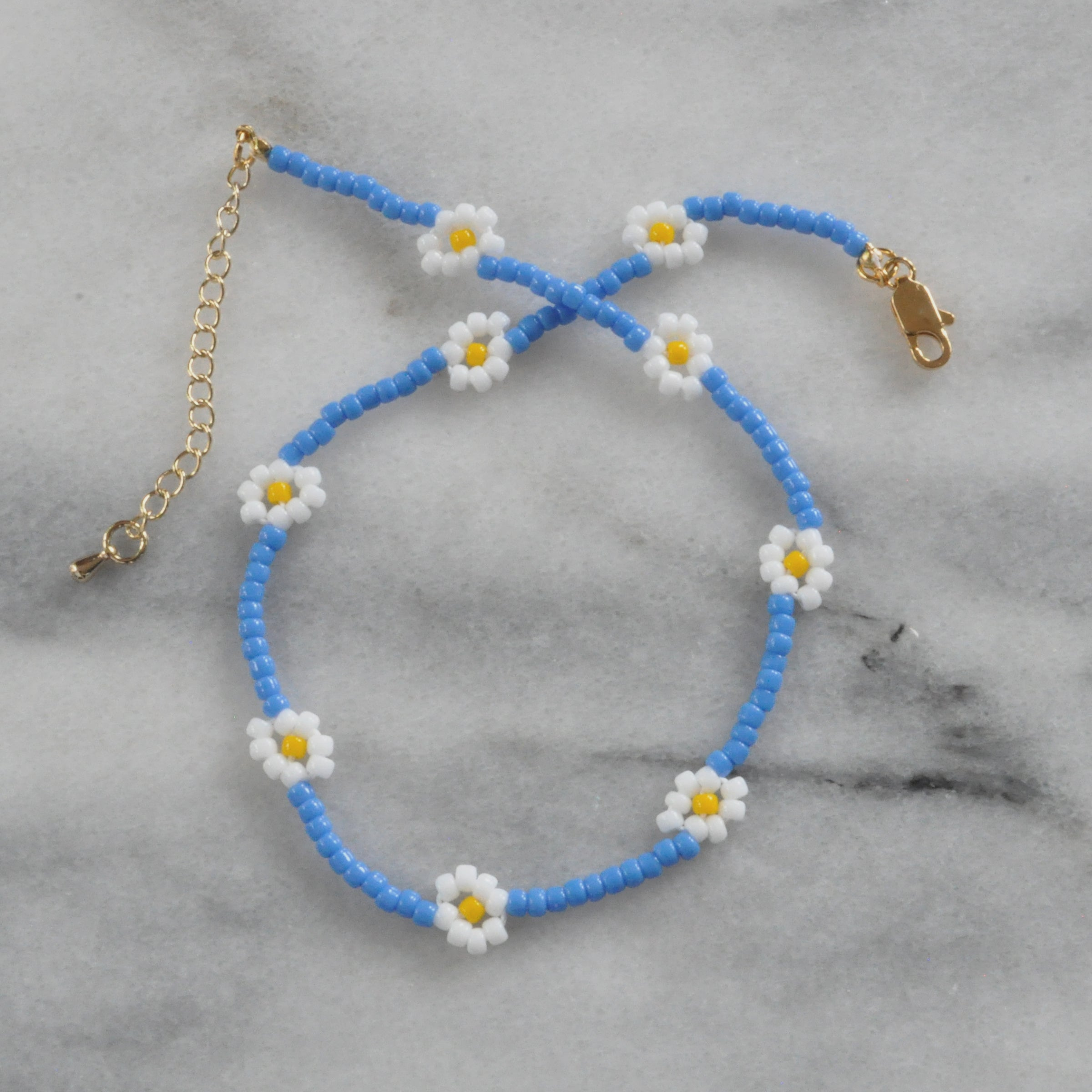 Libby & Smee daisy Chain choker in pool blue