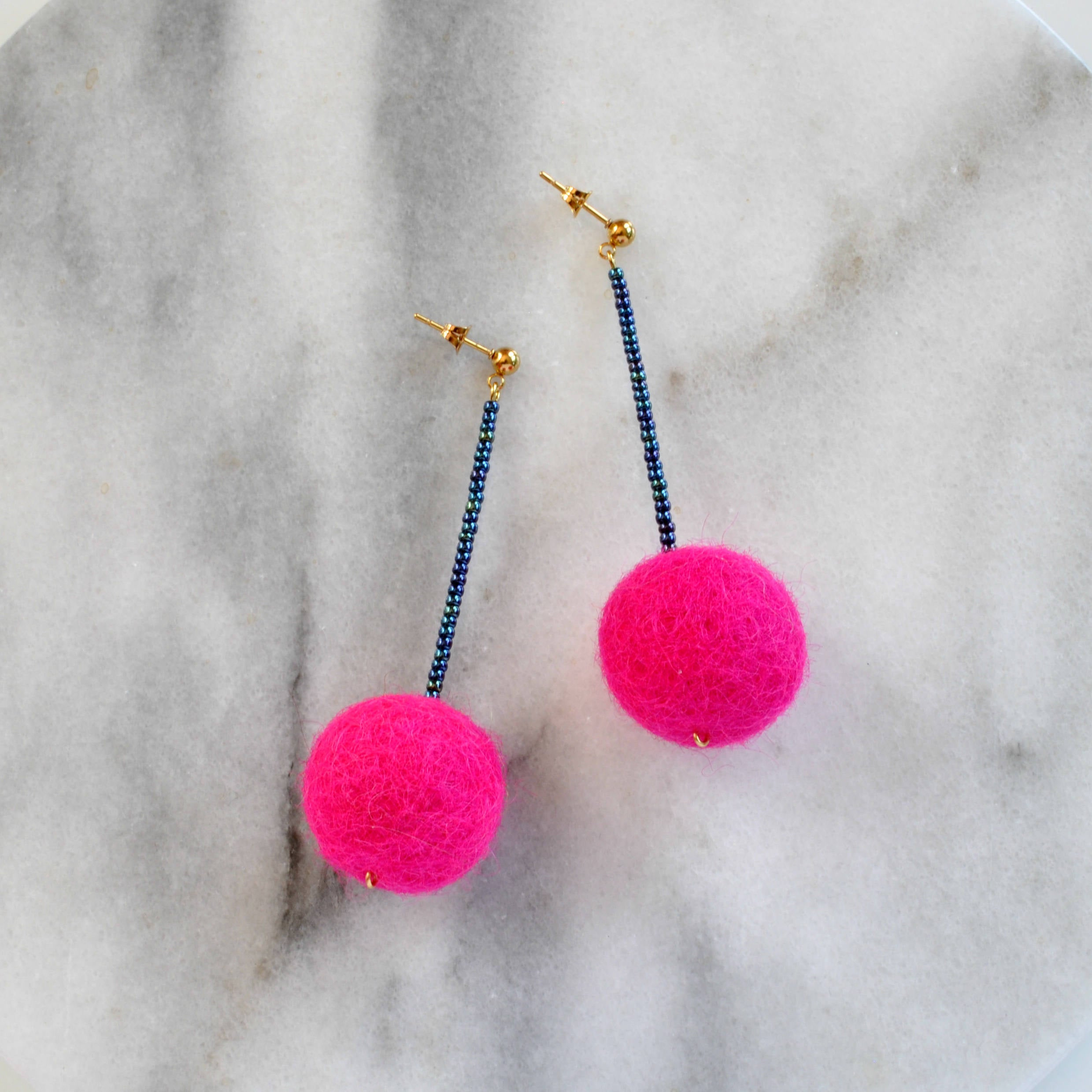 Libby & Smee Hot Pink Pom Pom Earrings with teal beads, still life