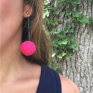 Libby & Smee Hot Pink Pom Pom Earrings with teal beads, on model