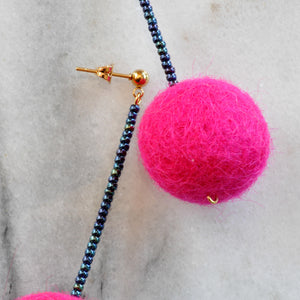 Libby & Smee Hot Pink Pom Pom Earrings with teal beads, close up