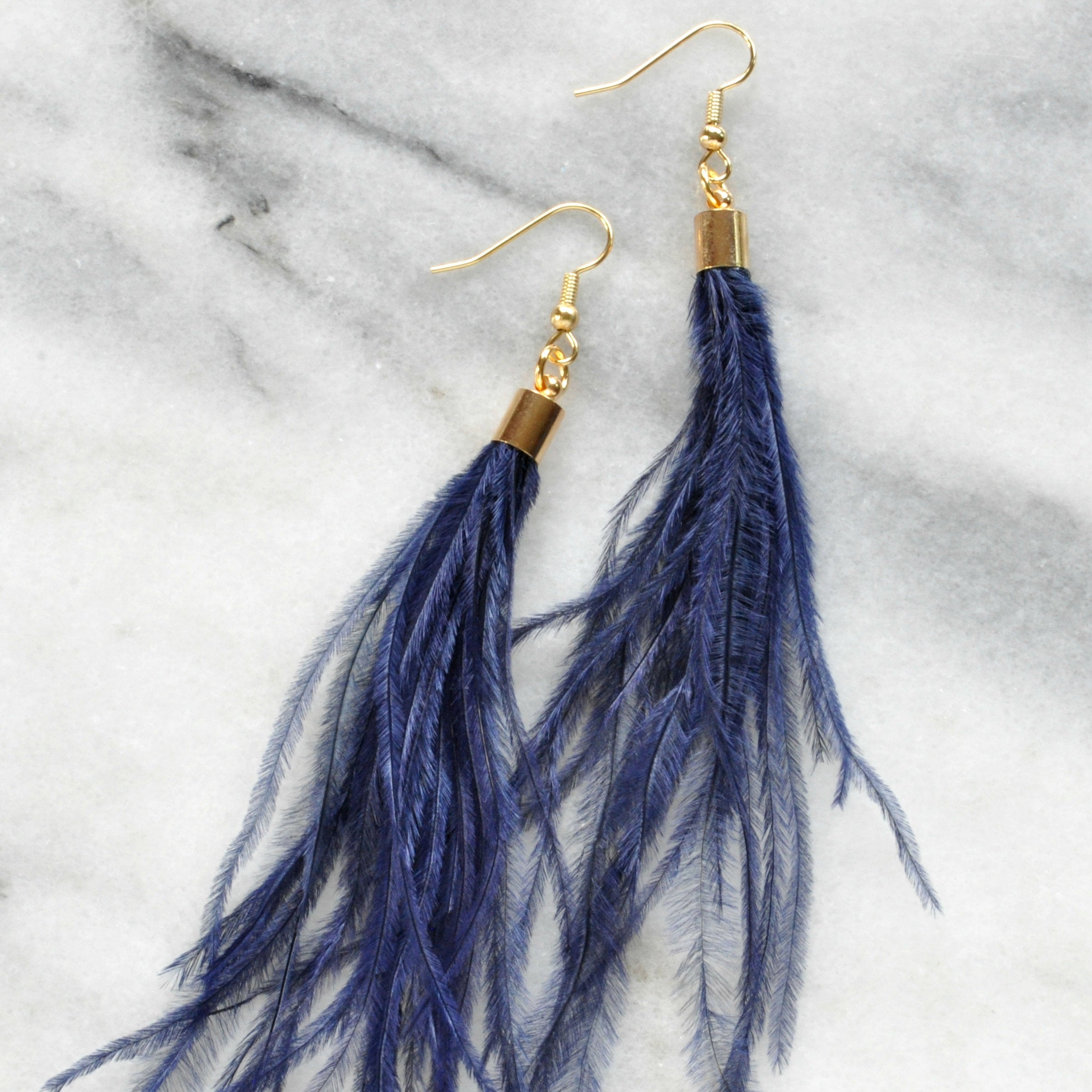 Libby & Smee Navy Blue Feather Earrings with Ostrich feathers and gold caps, close up