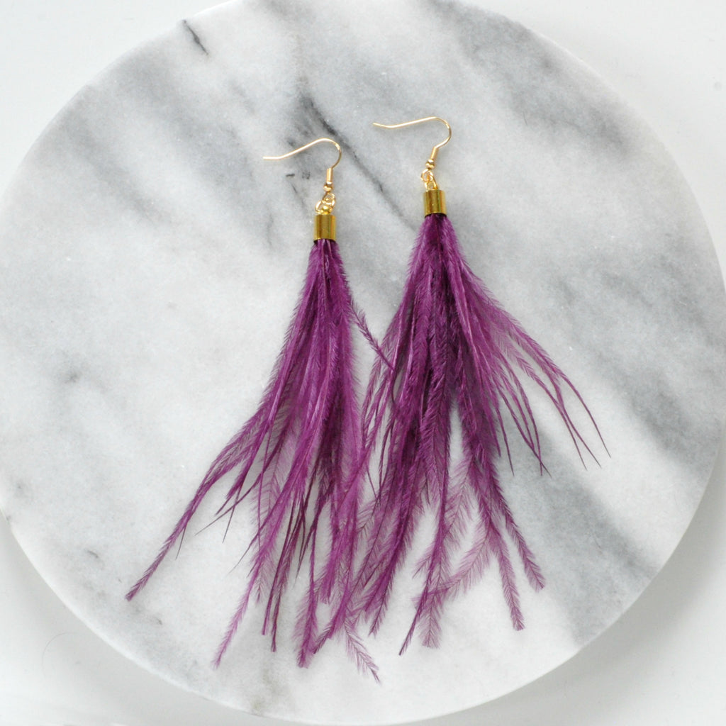 Libby & Smee Purple Feather Earrings with Ostrich feathers and gold caps, still life