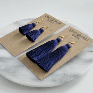 Libby & Smee Navy Tassel Earrings in Mini and Long on Kraft Earring Cards, Still life side angle