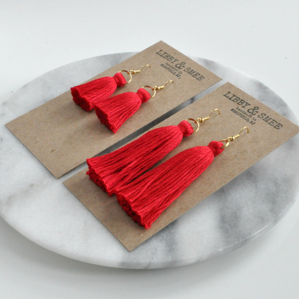 Libby & Smee red tassel earrings on gold earwires in mini or long on logo kraft earring cards, side angle