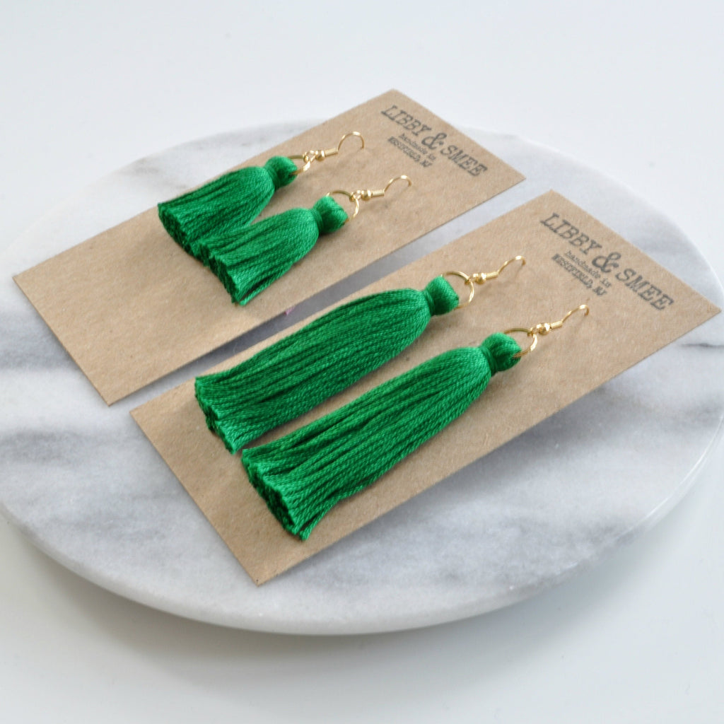 Emerald Green tassel earrings from Libby & Smee shown in mini and long sizes on logo-stamped kraft earring cards at an angle