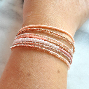 Libby & Smee beaded wrap bracelet strand in blush, on model
