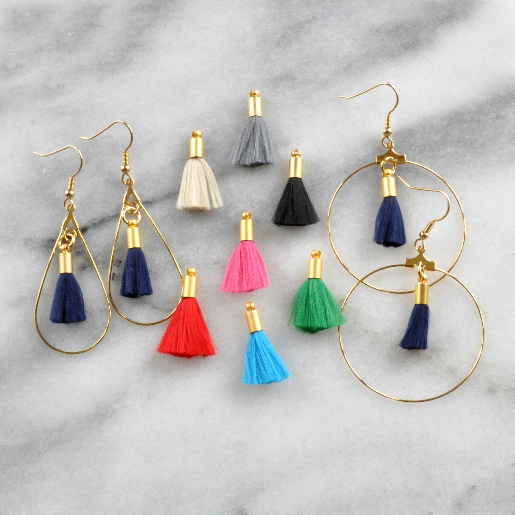 Libby & Smee tassel hoop earrings in teadrop shape and round shape with color options: navy blue, beige, grey, black, pink, red, turquoise, green