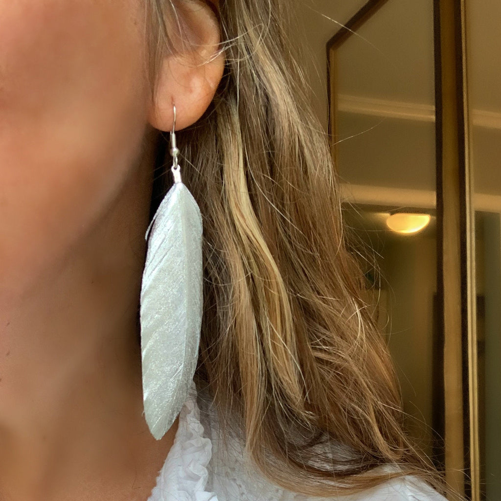 Libby & Smee Silver Feather Earrings on model