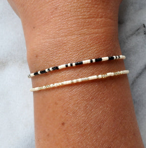 Libby & Smee Beaded Mosre Code Squad Girls Trip Bracelet in Cream with Black and Cream with Metallic, on wrist vertical