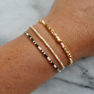 Libby & Smee Beaded Morse Code Squad Girls trip Bracelet in Cream with Black and Cream with Metallic, on wrist