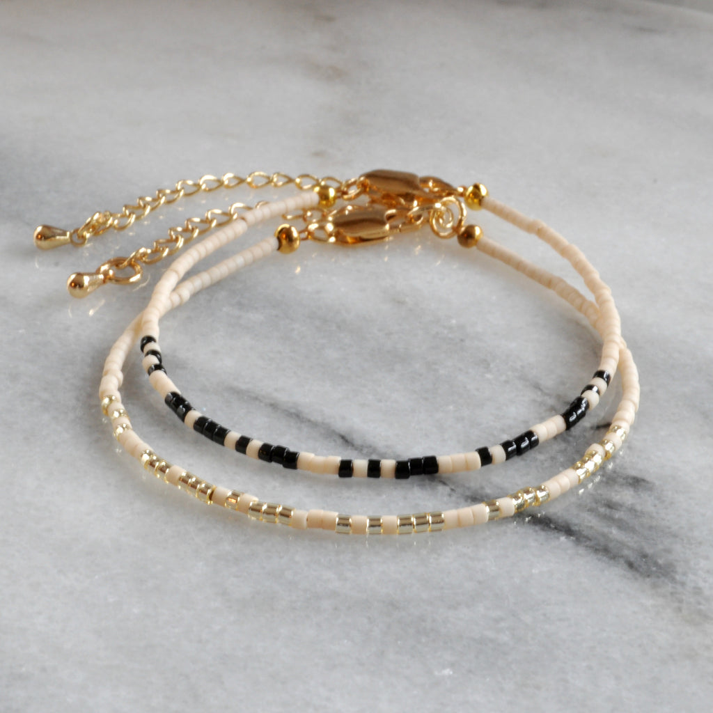 Libby & Smee Beaded Morse Code Squad Girls trip Bracelet in Cream with Black and Cream with Metallic, Still Life