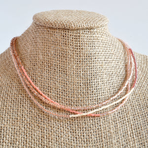 Libby & Smee beaded wrap bracelet strand in blush, on mannequin
