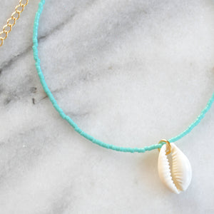 Libby & Smee Seashell Choker Necklace in turquoise with a cowrie seashell, Close up