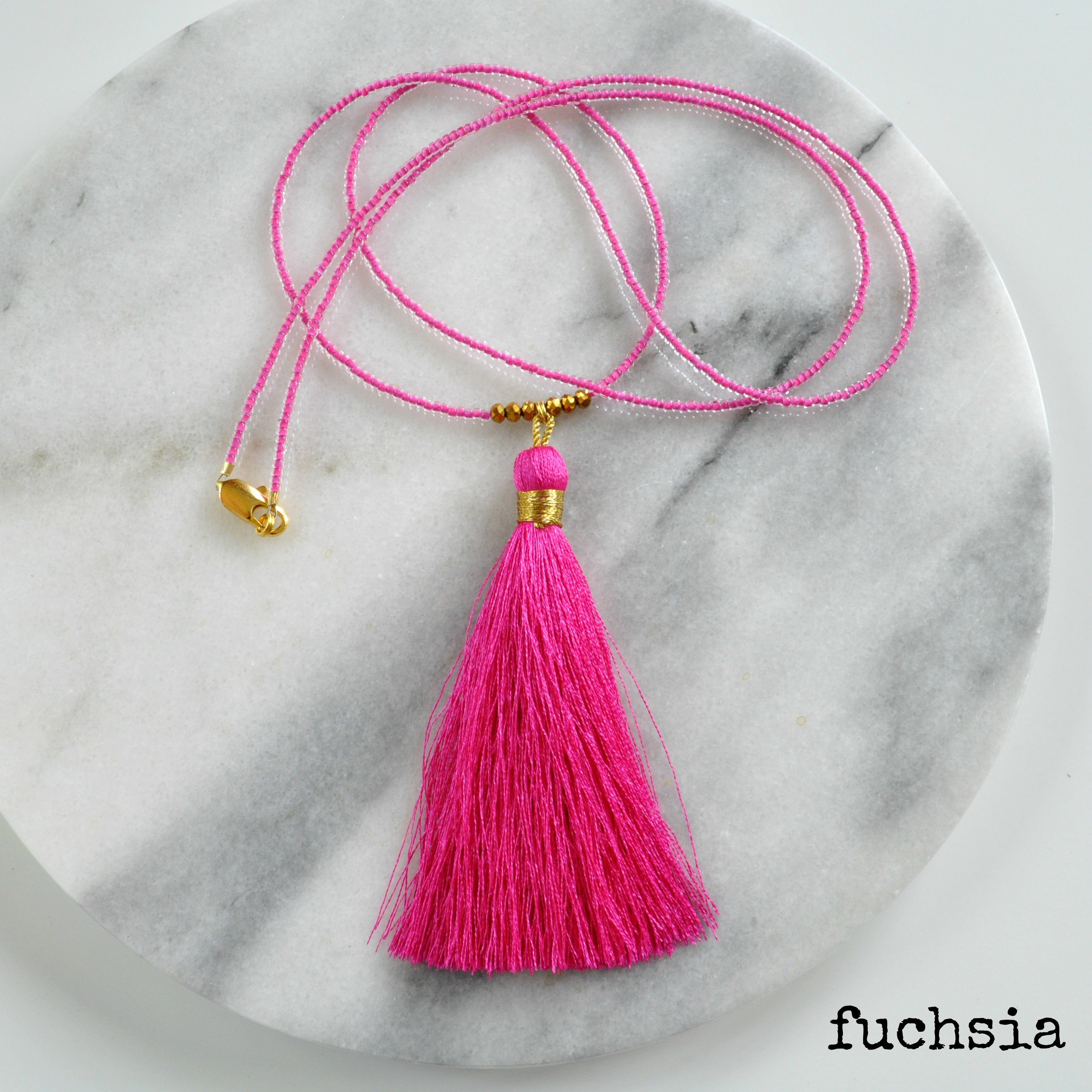 Libby & Smee Beaded Tassel Necklace in  Fuchsia, still life labeled
