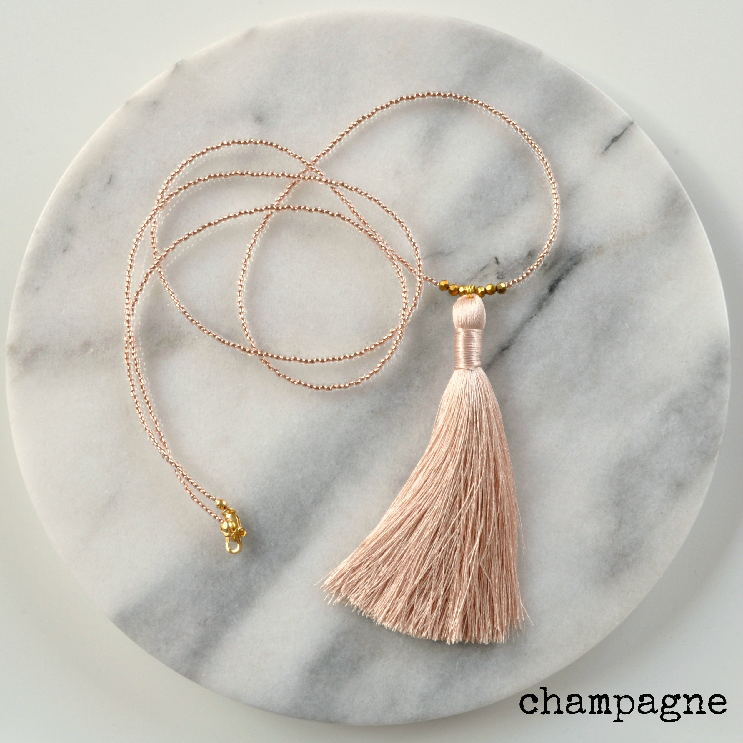 Libby & Smee Beaded Tassel Necklace in Champagne, still life labeled