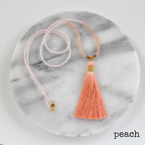 Libby & Smee Beaded Tassel Necklace in Peach, still life labeled