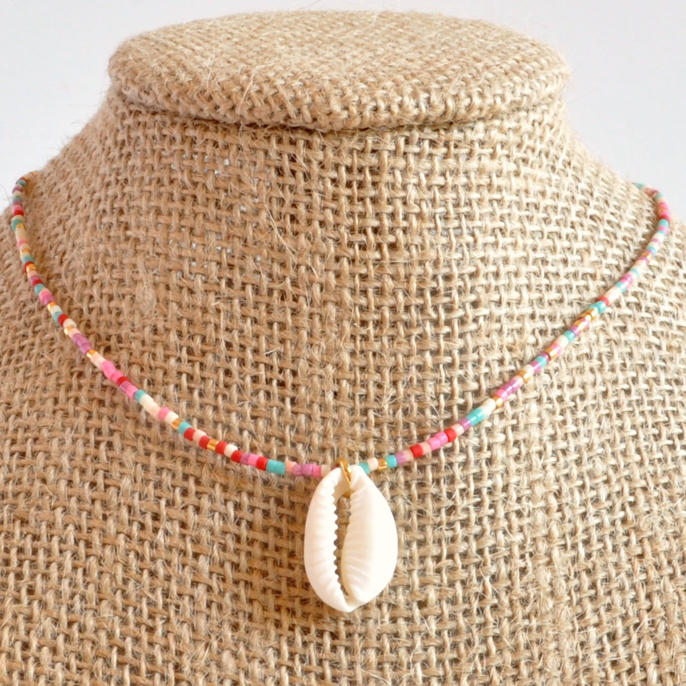 Libby & Smee Seashell Choker Necklace in Cotton Candy Mix: pink, purple, peach gold, ivory, on mannequin