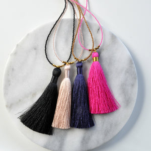 Libby & Smee Beaded Tassel Necklace in Black, Champagne, Navy and Fuchsia, still life