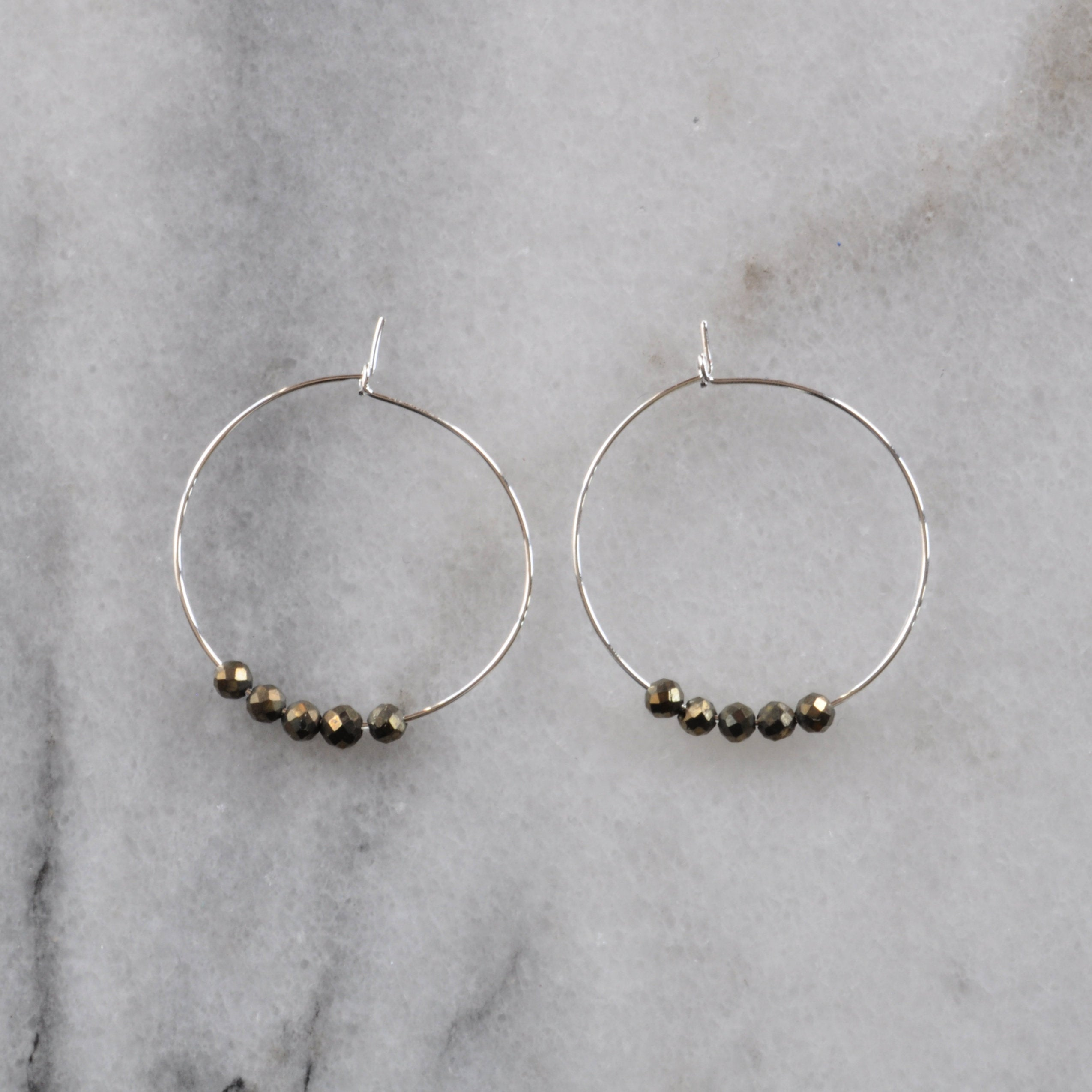 Libby & Smee Small Pyrite Hoop Earrings on 25mm silver plated hoops, still life