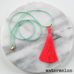 Libby & Smee Beaded Tassel Necklace in coral and green, still life labeled Watermelon