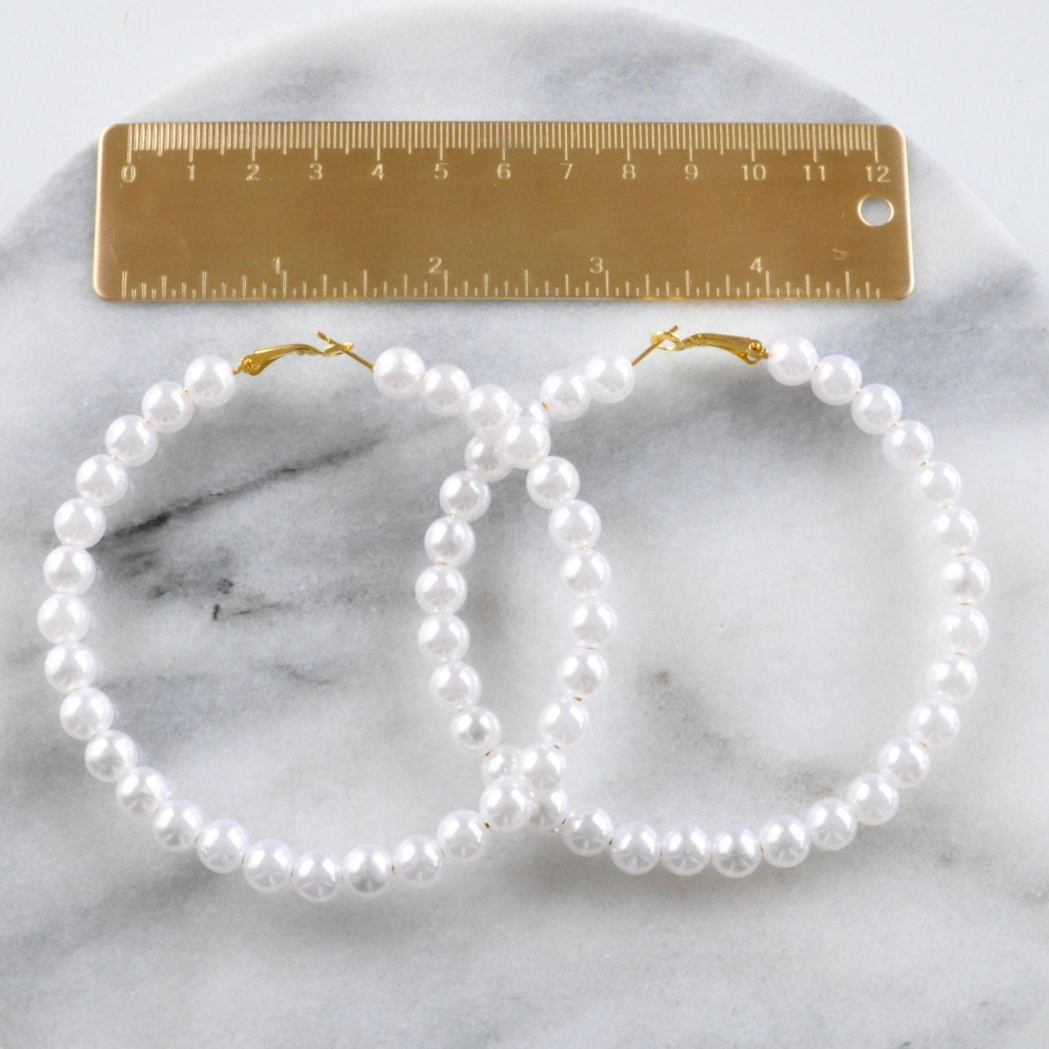 Libby & Smee Huge Pearl Hoops with ruler for scale