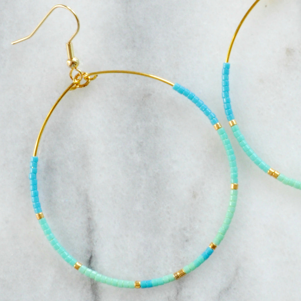 "Libby & Smee Big Beaded Hoops in ""Aruba"" style with gold-plated ear wire and small seed beads in turquoise, aqua, mint and gold in size ""big"" teardrop shape - close up"