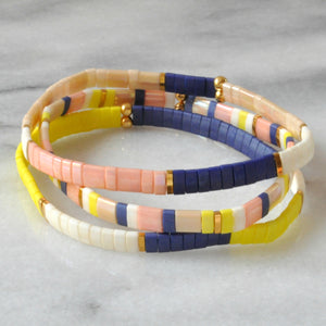 Classic Set of Libby & Smee stretch tile bracelets includes Yellow Colorblock in navy, ivory and yellow, Classic Colorblock in navy, ivory, blush and beige and The Classic, a mix of navy, ivory, beige, blush , yellow and gold. The three bracelets combine make up this tile bracelet curated set.