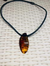 Load image into Gallery viewer, Amber pendant on leather - necklace