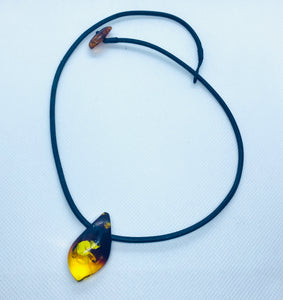 Amber necklace and pendant on leather
