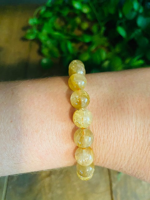 Golden Rutile in Quartz bead bracelet