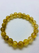 Load image into Gallery viewer, Golden Rutile in Quartz bead bracelet