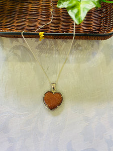 Gold stone heart shaped pendant set in sterling silver