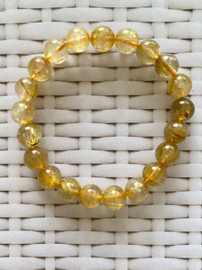 Golden Rutile in Quartz round bead bracelet