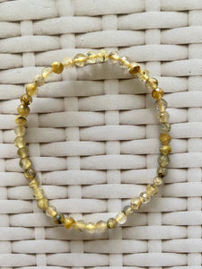 Golden Rutile in Quartz faceted bead bracelet