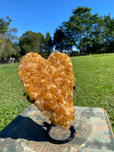 Large orange Calcite crystal love heart on black stand - home decor or bedroom display