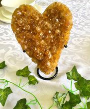 Load image into Gallery viewer, Large orange Calcite crystal love heart on black stand - home decor or bedroom display