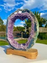 Load image into Gallery viewer, Natural Amethyst Crystal slice on wooden stand -  home décor or unique table piece