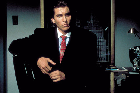 Christian Bale in a classic 1980s couture suit as Patrick Bateman in American Psycho.