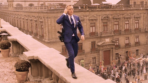 Daniel Craig as James Bond. Walking on a rooftop above a Dia de los Muertos (Day of the Dead)celebration in Mexico City.