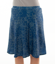Load image into Gallery viewer, Freestyle Swim Skirt for Junior Sizes by Dressing For His Glory  Our Freestyle Swim Skirt is a great skirt to swim in. It is made in a chlorine resistant swimwear fabric that stretches with you and dries quickly! The skirt has bike short underneath and are attached at the elastic waist. The Freestyle Swim Skirt is great looking and keeps you cool and comfortable.