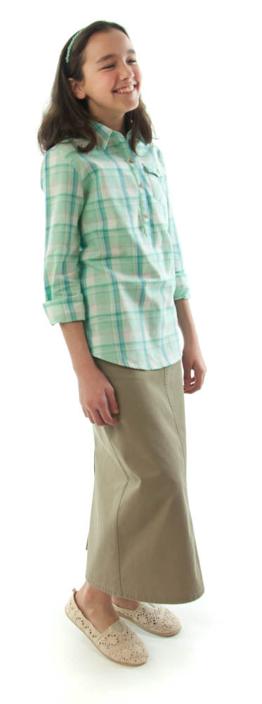 Long Jean Skirt for Girl Sizes by Dressing For His Glory The Long Jean Skirt is still a great look for today! You will love our Long Jean Skirt for Girls because of  its adjustable waistband. It will adjust to fit your daughter perfectly! It has a front fly zipper opening, change pockets andi it has a back slit. This skirt is great for everyday and is durable as well as comfortable. And it has been pre washed so you won't have to worry about shrinkage!