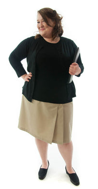 The School Uniform Skirt for Women's Plus Sizes by Dressing For His Glory has two off centered pleats in the front and back. It has a single button front closure with a small pocket. The skirt has a contour waistband and is comfortable, extremely durable, stain resistant, and great looking the entire school year!