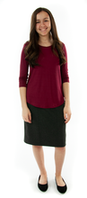 Load image into Gallery viewer, Short Straight Knit Skirt for Junior Sizes by Dressing For His Glory  You are going to love the feel and comfort of our Short Straight Knit Skirt. Made in a double knit fabric, it is great for fall, winter and even spring time weather. No more clinging to your stocking or tights since it is fully lined in a soft tricot fabric. It has a smooth elastic waistband and a small back slit. This skirt has a beautiful straight look without going all in at the hem. Easy to wear and wash!
