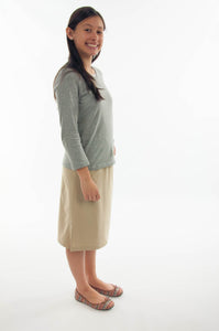 "The Straight Skort for Junior Sizes by Dressing For His Glory is a straight cut skirt with loose fitting shorts underneath and are attached at the waist. It has slits on each side seam for easy leg movement and an elastic waistband. The shorts are made of the same fabric and are 1"" shorter than the outer layer skirt."