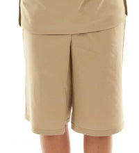 "Load image into Gallery viewer, The Straight Skort for Junior Sizes by Dressing For His Glory is a straight cut skirt with loose fitting shorts underneath and are attached at the waist. It has slits on each side seam for easy leg movement and an elastic waistband. The shorts are made of the same fabric and are 1"" shorter than the outer layer skirt."