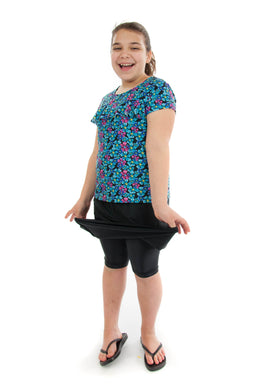 Freestyle Swim Skirt for Girls Plus Sizes by Dressing For His Glory  Our Freestyle Swim Skirt is a great skirt to swim in. It is made in a chlorine resistant swimwear fabric that stretches with you and dries quickly! The skirt has bike short underneath and are attached at the elastic waist. The Freestyle Swim Skirt is great looking and keeps you cool and comfortable.