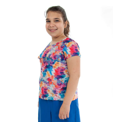 Swim Tee for Girls Plus Size by Dressing For His Glory  Our Swim Tees are made in top quality, fast drying swimwear knit fabric. The fabric is chlorine resistant, cool and comfortable. The swim tee is fully lined and helps to prevent clinging. It has a scooped neck and a choice of a cap sleeves or a longer length sleeve. It also has a beautiful ruffle across the yoke.