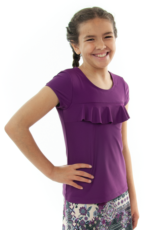 Swim Tee for Girls by Dressing For His Glory  Our Swim Tees are made in top quality, fast drying swimwear knit fabric. The fabric is chlorine resistant, cool and comfortable. The swim tee is fully lined and helps to prevent clinging. It has a scooped neck and a choice of a cap sleeves or a longer length sleeve. It also has a beautiful ruffle across the yoke.