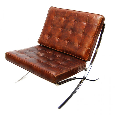 Beautiful armless button tufted leather chair with criss cross legs...