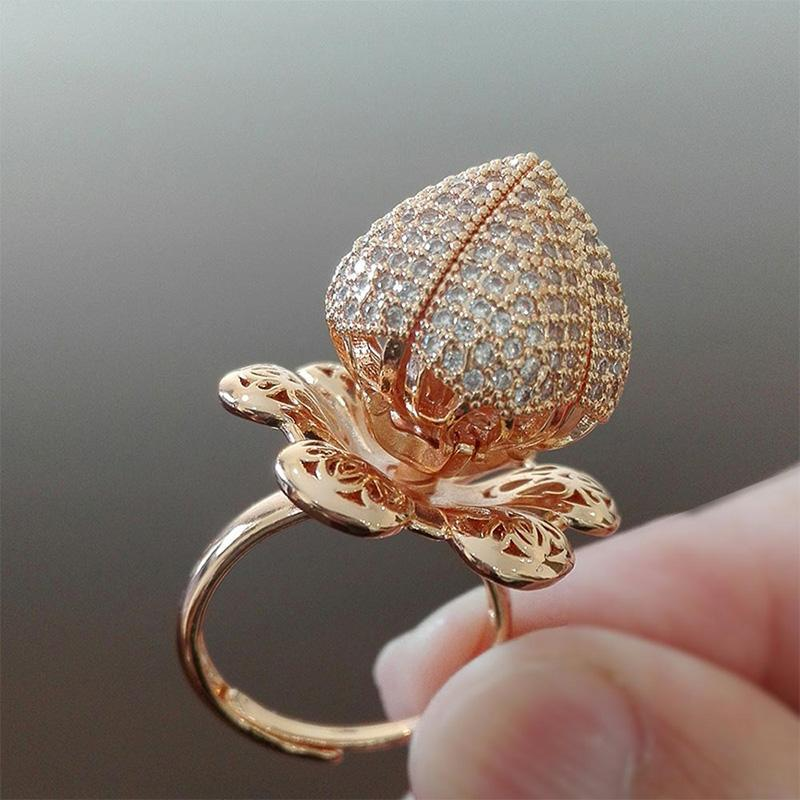 ROTATING ROSE RING